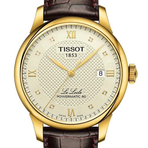 Die Tissot Le Locle Gent in Edelstahl mit gelbgoldfarbener PVD-Beschichtung mit acht Diamantindizes am Lederband. 690 Euro.