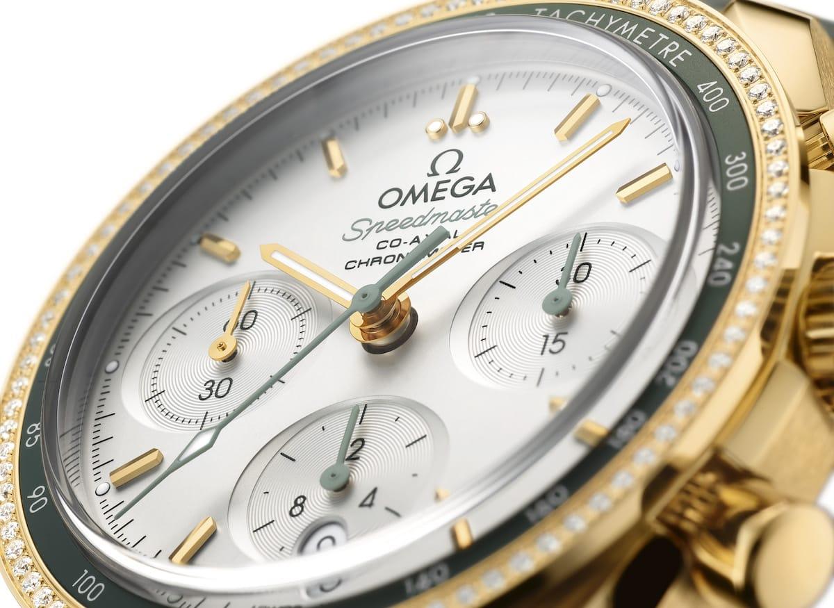 Omega Speedmaster 18K Gold Grüne Diamantlünette